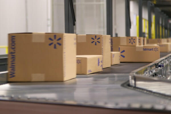 Walmart boxes on conveyor belt for shipping