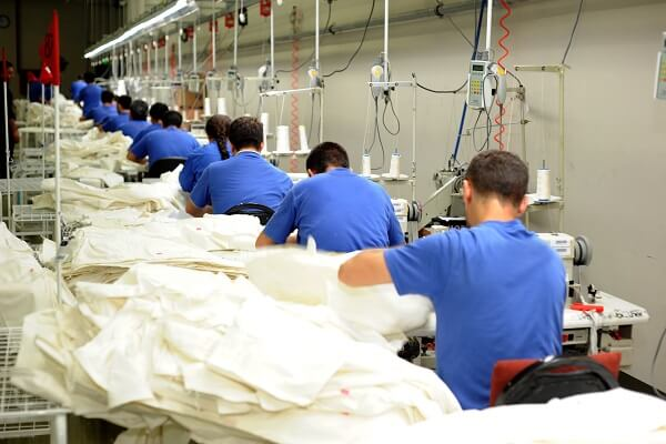 workers sewing clothes in a garment factory