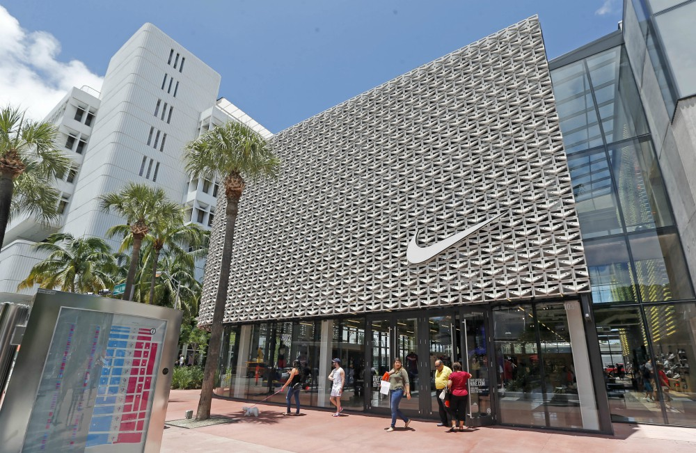 Nike promotes two women in the wake of a scandal over inappropriate behavior.