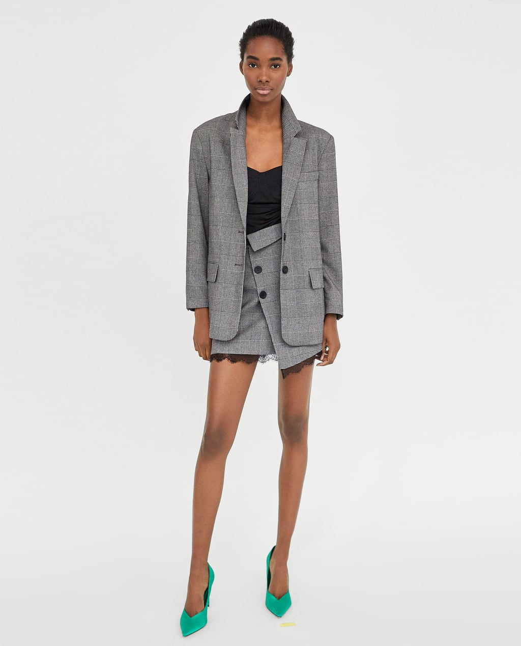 WGSN said skirt suits with shorter hemlines like this set from Zara offer an feminine replacement to trousers.