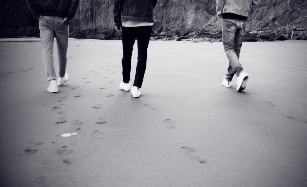 people wearing jeans on beach