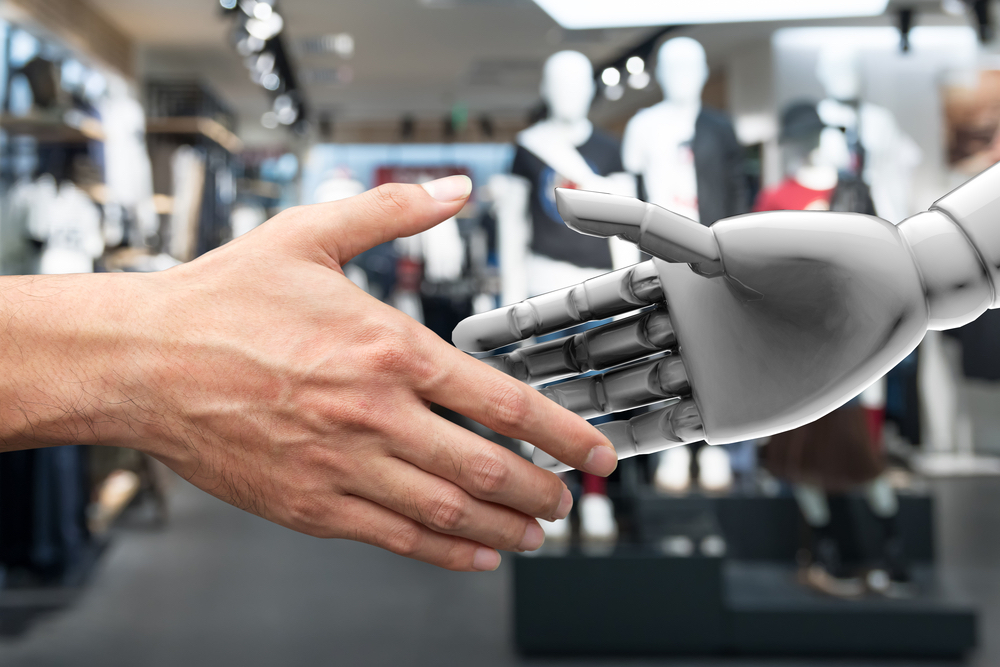 Human hand shaking a robot hand