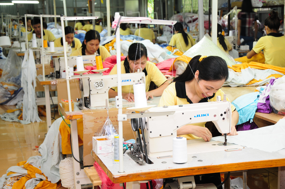 women sewing clothing in Vietnam factory