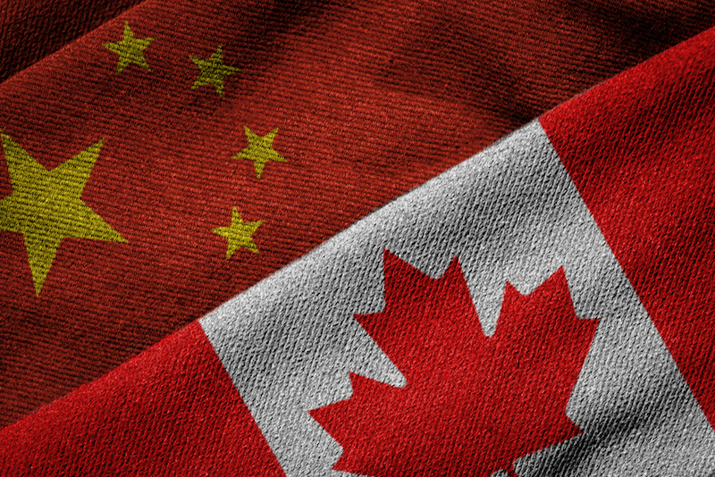 3D rendering of the flags of China and Canada on woven fabric texture.