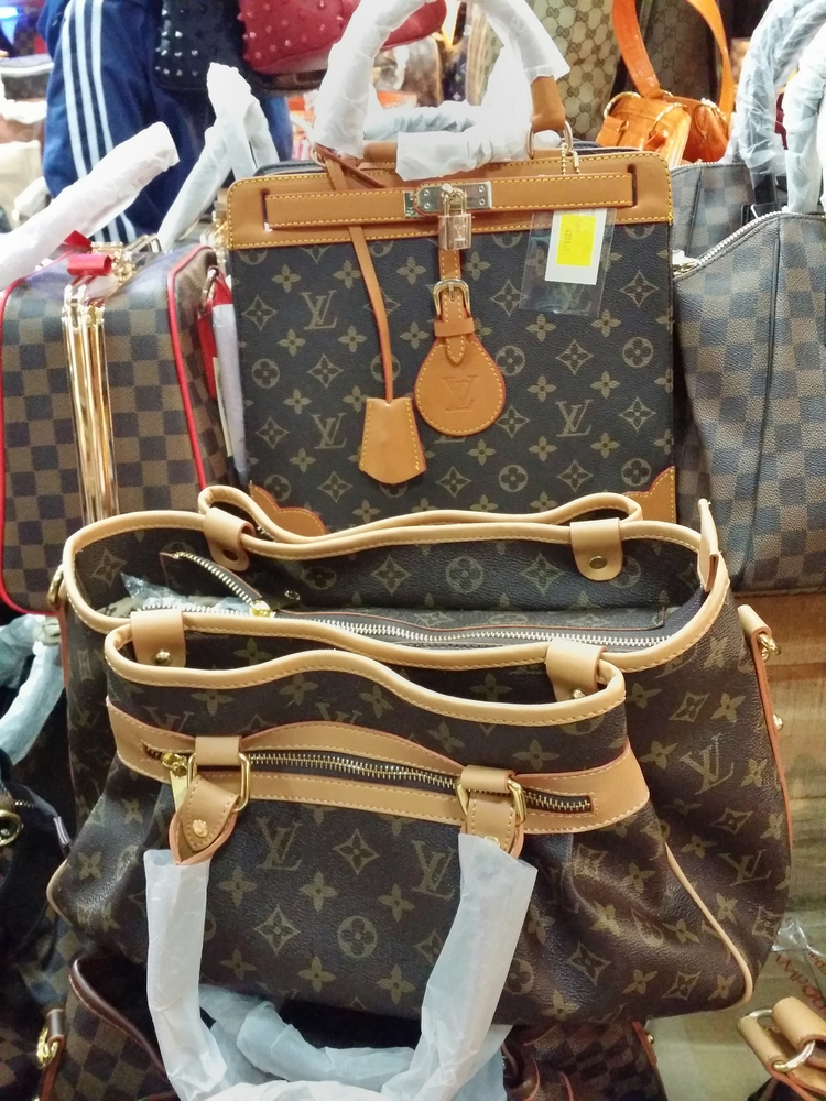 A collection of fake designer handbags