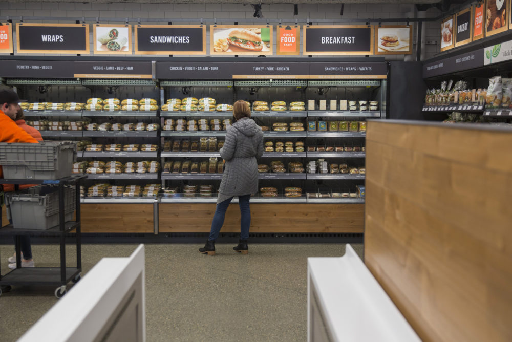 An Amazon.com Inc. employee shops for prepared food at the Amazon Go store