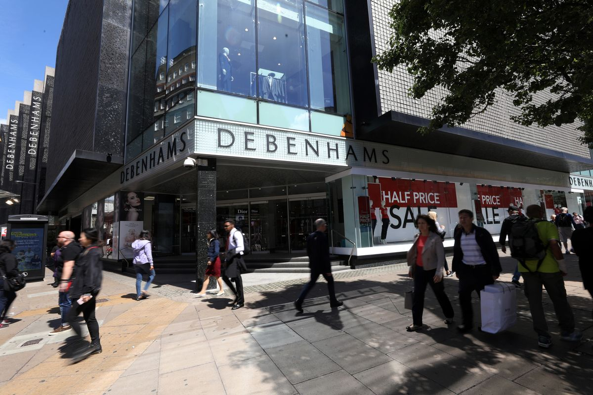 Pedestrians pass a Debenhams Plc department store in London, U.K.