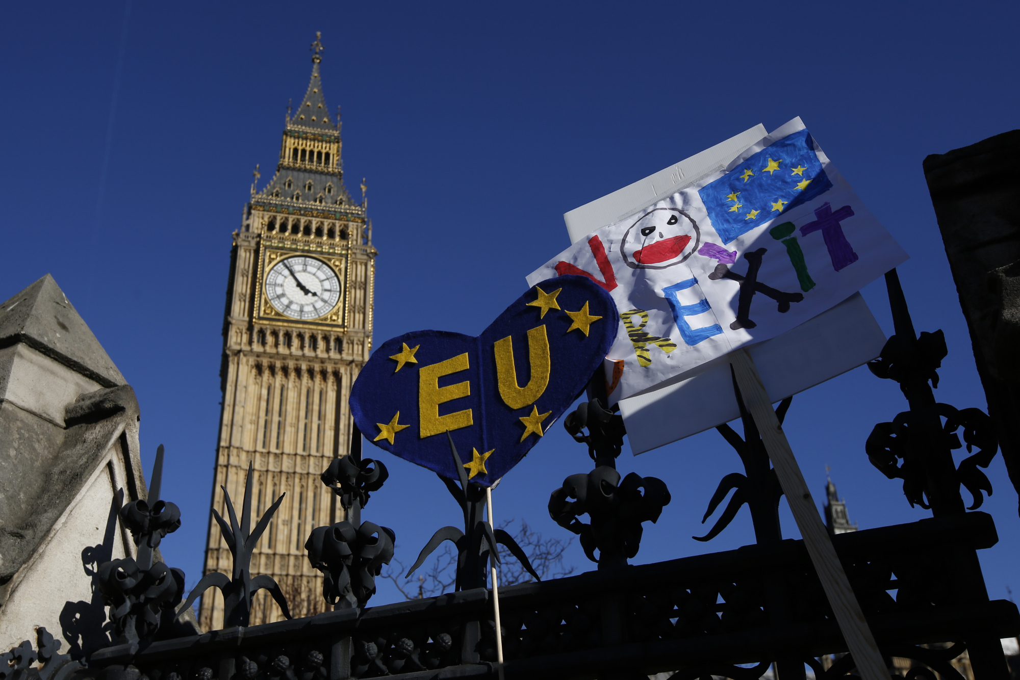 Pro-EU slogans and banners rest on the perimeter fence of the Houses of Parliament