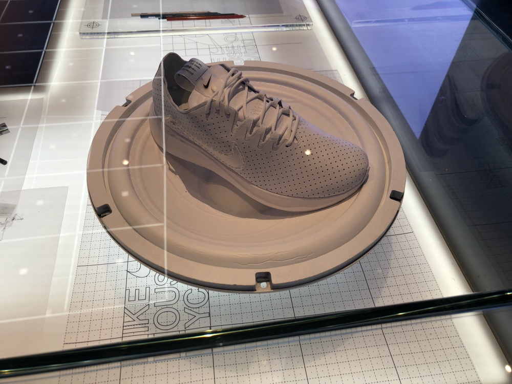 As costumers walk in the store, they are greeted by the Nike Arena. The room is customizable, down to  the color of the floor tiles, for any event or ad campaign. A customization studio, called Nike by You, lets you decorate your own sneakers next door by appointment.