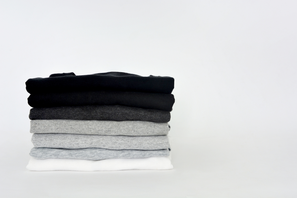 stack of black and grey T-shirts