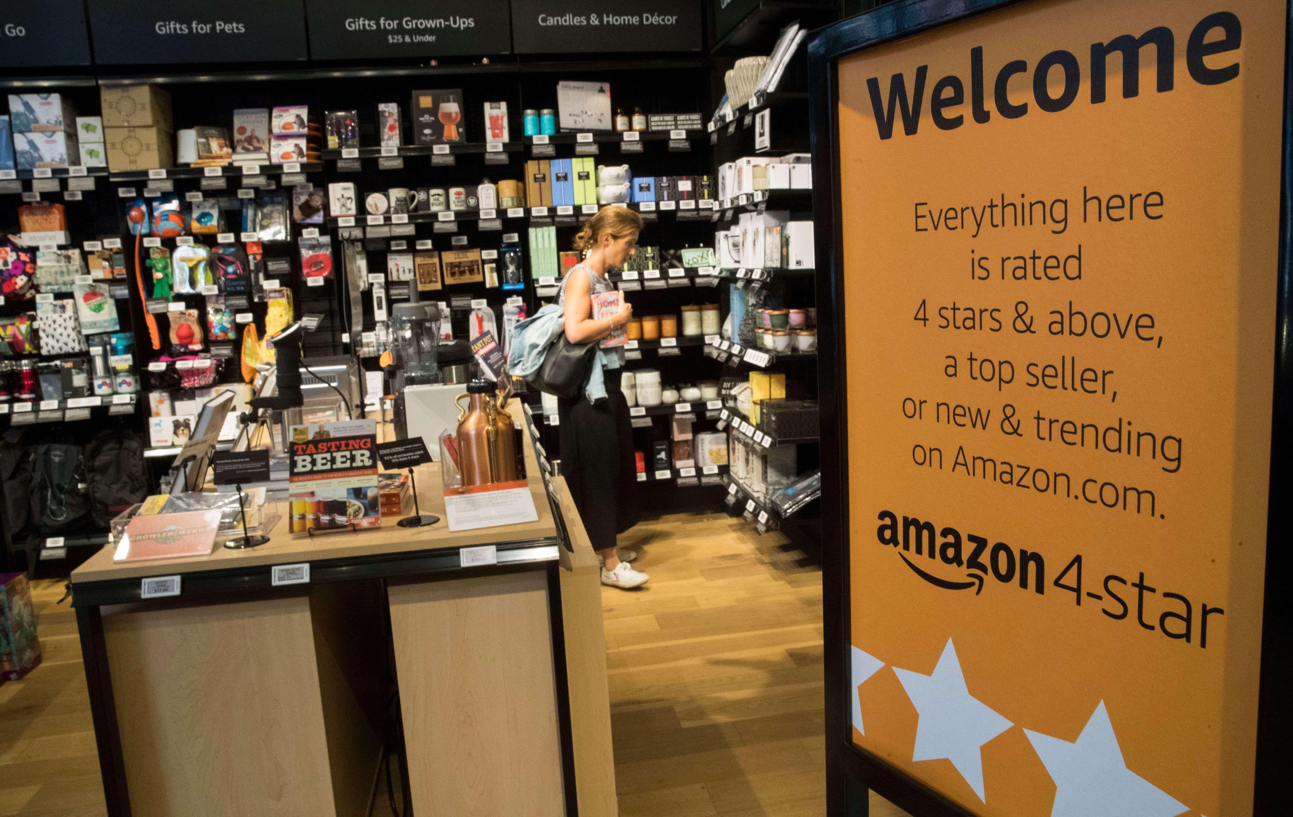 A shopper browses the items on display at the Amazon 4-star store