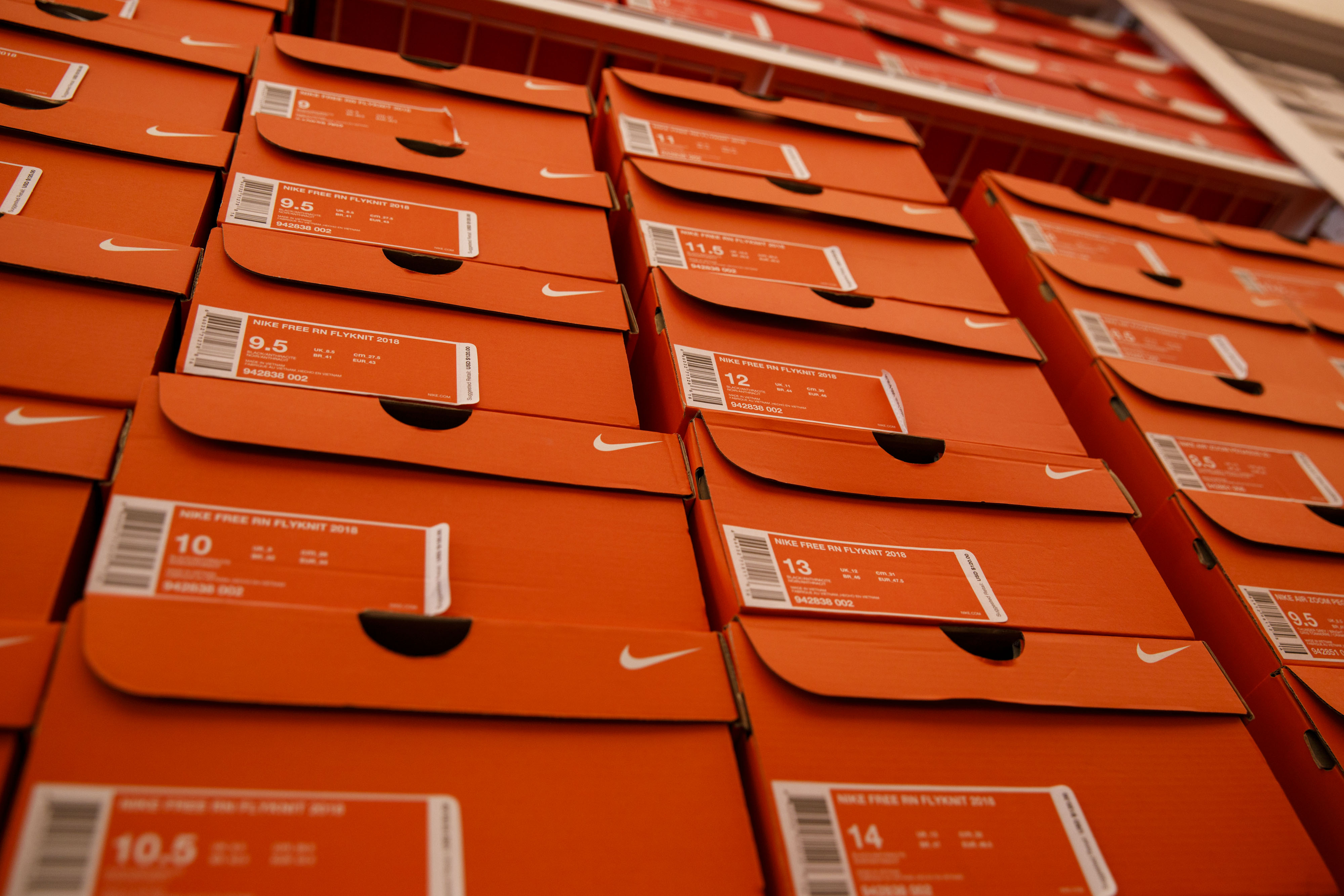 boxes of stacked Nike sneakers