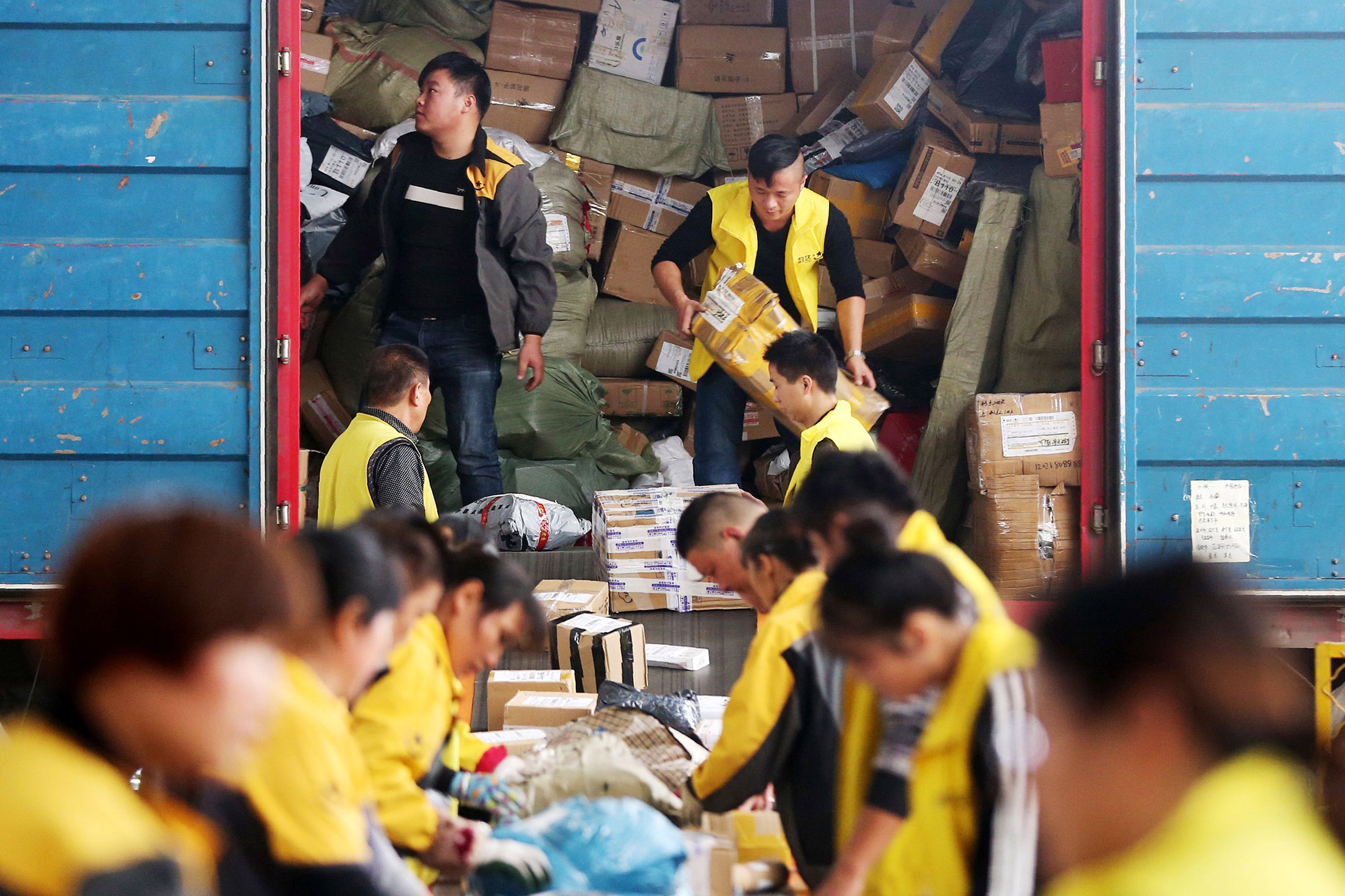 employees sorting packages ahead of Singles Day in China