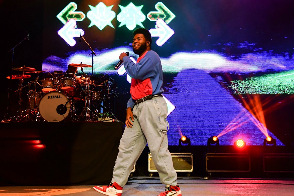 Musician Khalid in concert at September's Washington State Fair in Puyallup. His baggy khakis, hi-top Nikes and normcore-style color-blocked shirt represent a common style in the 1990s.