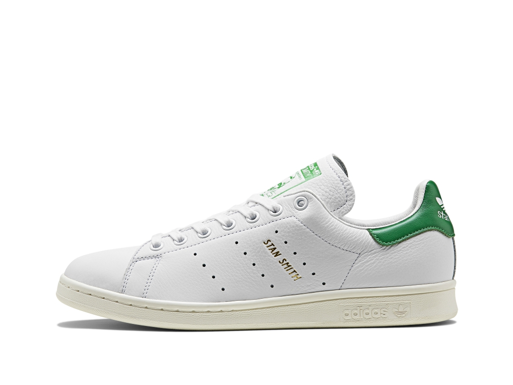 "A golden ""Stan Smith"" decal will differentiate this commemorative pair from a standard pair of Stan Smith's."