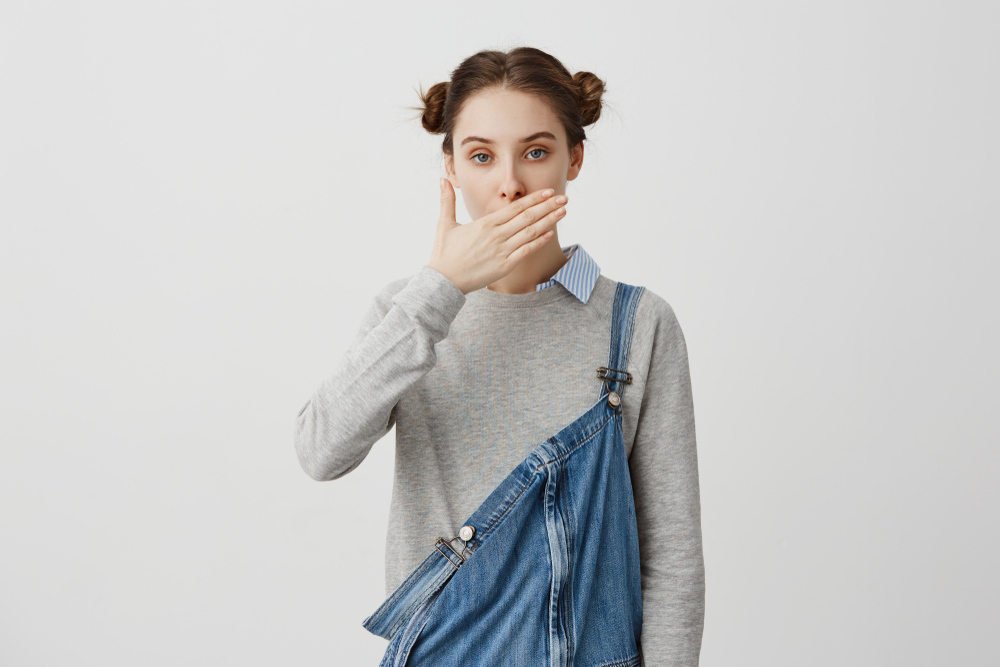 person covering mouth