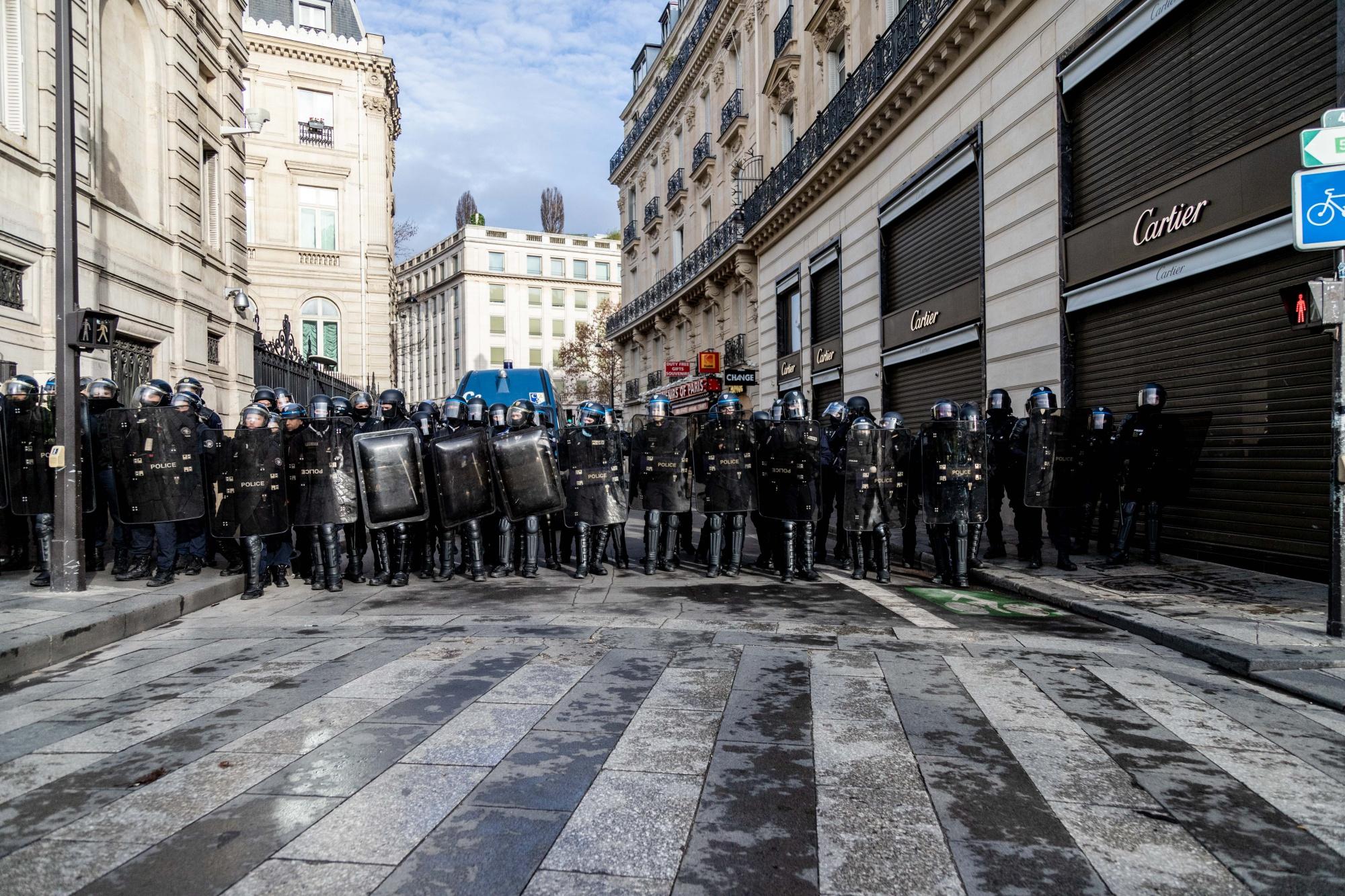 Police form a blockade near a shuttered Cartier store in Paris