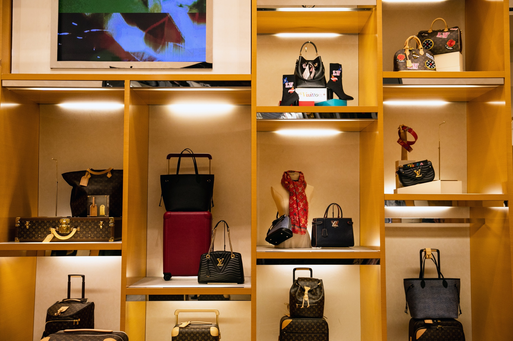 Louis Vuitton SE bags sit on display at the Macy's Inc. flagship store in New York,