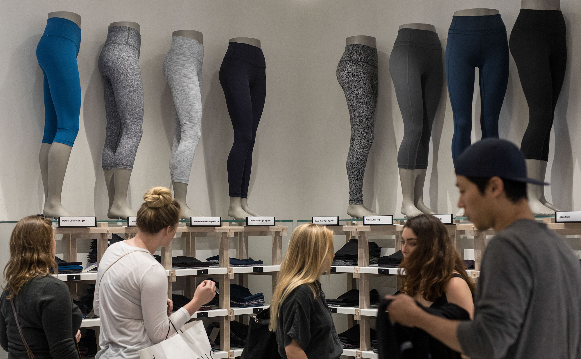 Shoppers look at clothes on display at the Lululemon store