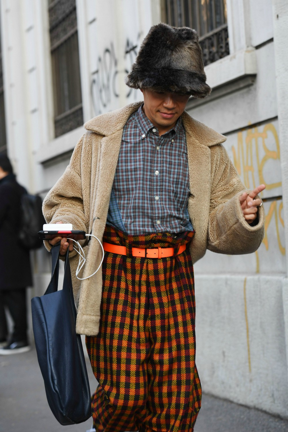 Here, one style-savvy gent throws plaid into his print mixing.