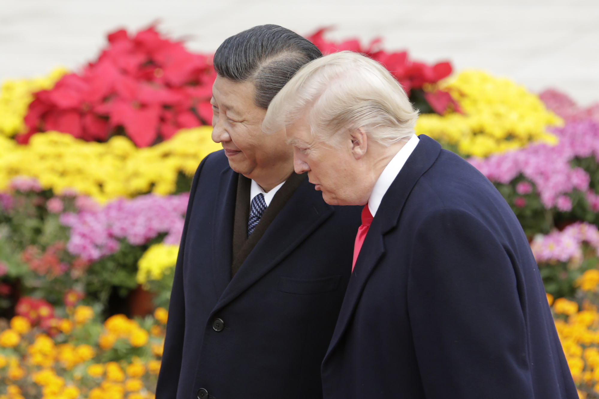 U.S. President Donald Trump, right, speaks with Xi Jinping, China's president, during a welcome ceremony outside the Great Hall of the People in Beijing, China, on Thursday, Nov. 9, 2017.