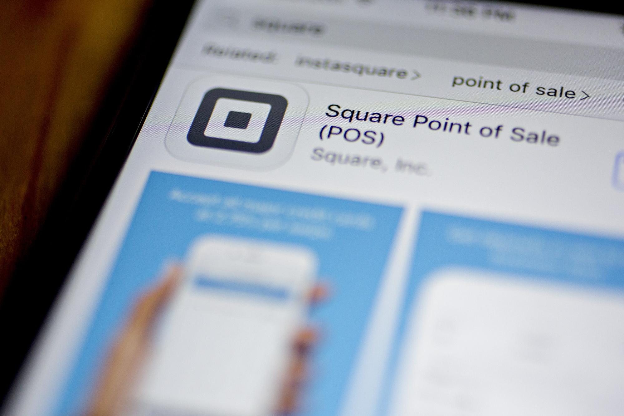 The Square Inc. Point of Sale application is seen in the App Store on an Apple Inc. iPhone