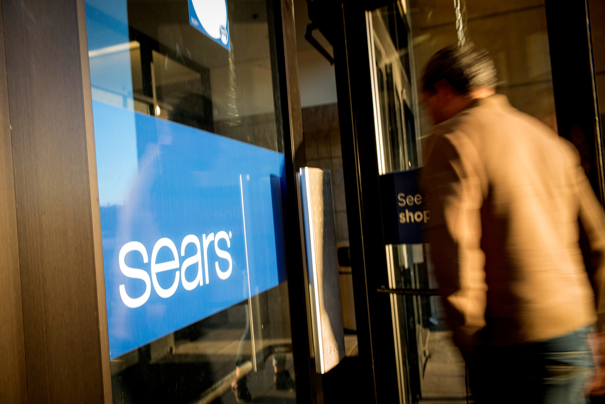 A customer enters a Sears Holdings Corp. store in San Bruno, California