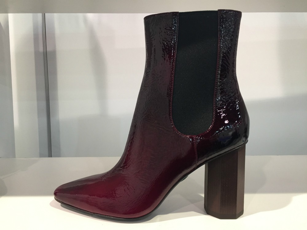 Donald Pliner's heeled Chelsea boot featured a rich oxblood patent with an ombre effect
