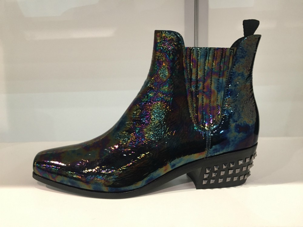 Bringing to mind ripples on water or an oil slick on a wet city street, this fall season's crinkled, iridescent patents have hit the women's boot scene in a big way.