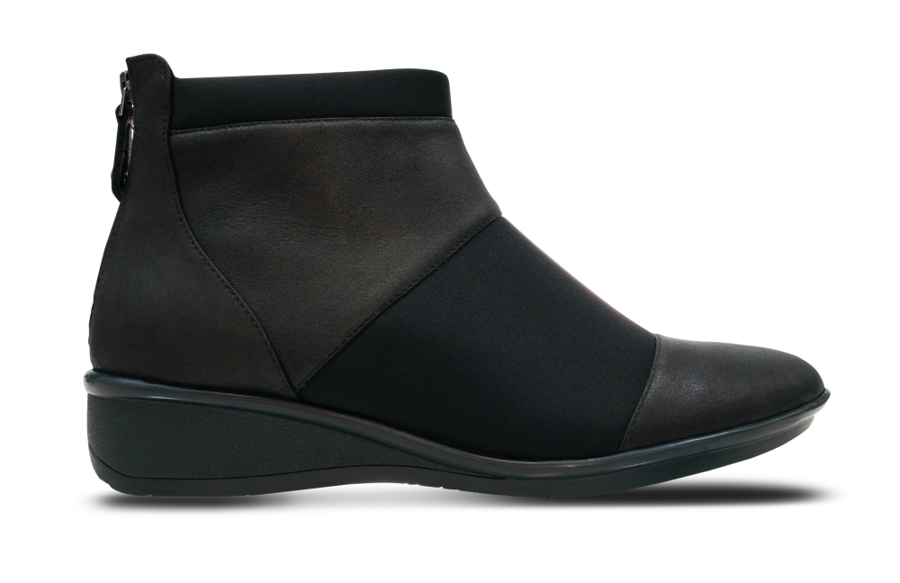 "Anne Truscott described the Aspen style as a ""sleek leather and neoprene paneled bootie that molds to the shape of the foot."" The combination of materials adds ""flexibility for greater ease of movement,"" she said, and it contributes to the style's modern aesthetic."