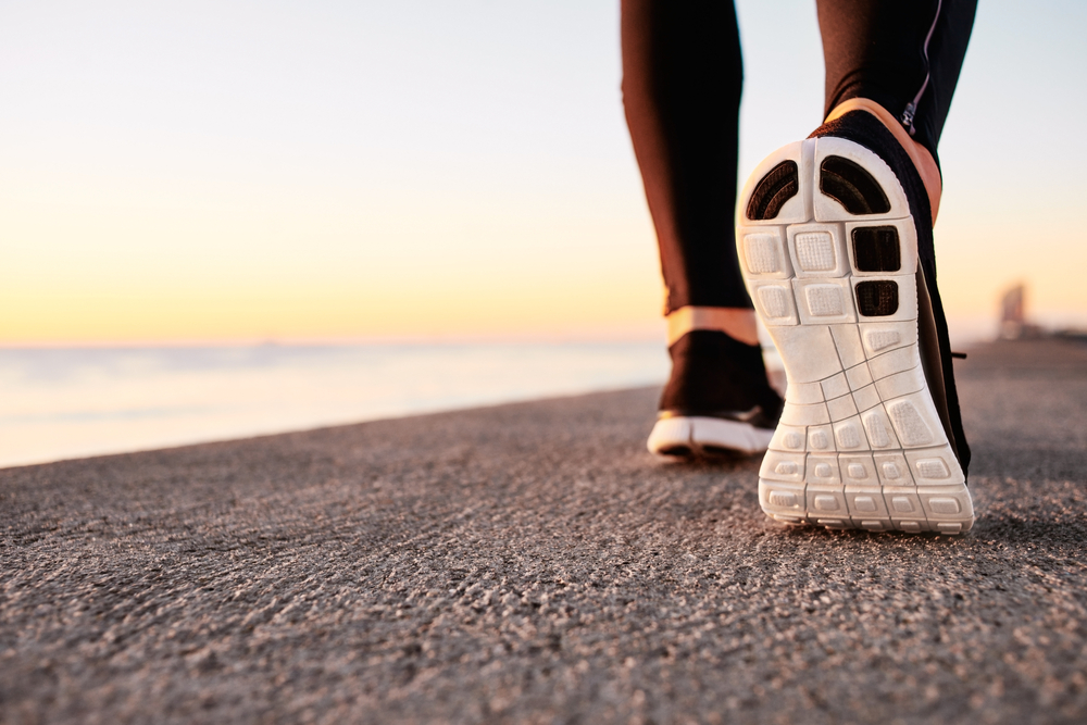 Image of a sneaker on the beach at sunset