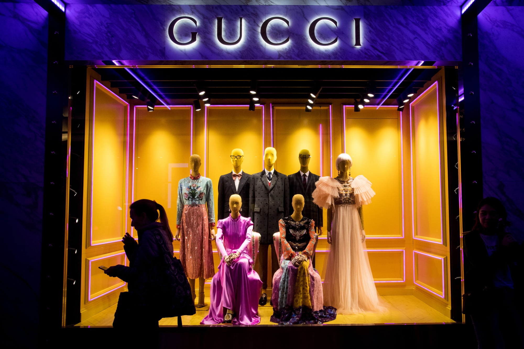 A pedestrian walks past a window display at a Guccio Gucci SpA store at Harbour City shopping mall, operated by Wharf Holdings Ltd., in the Tsim Sha Tsui district of Hong Kong, China