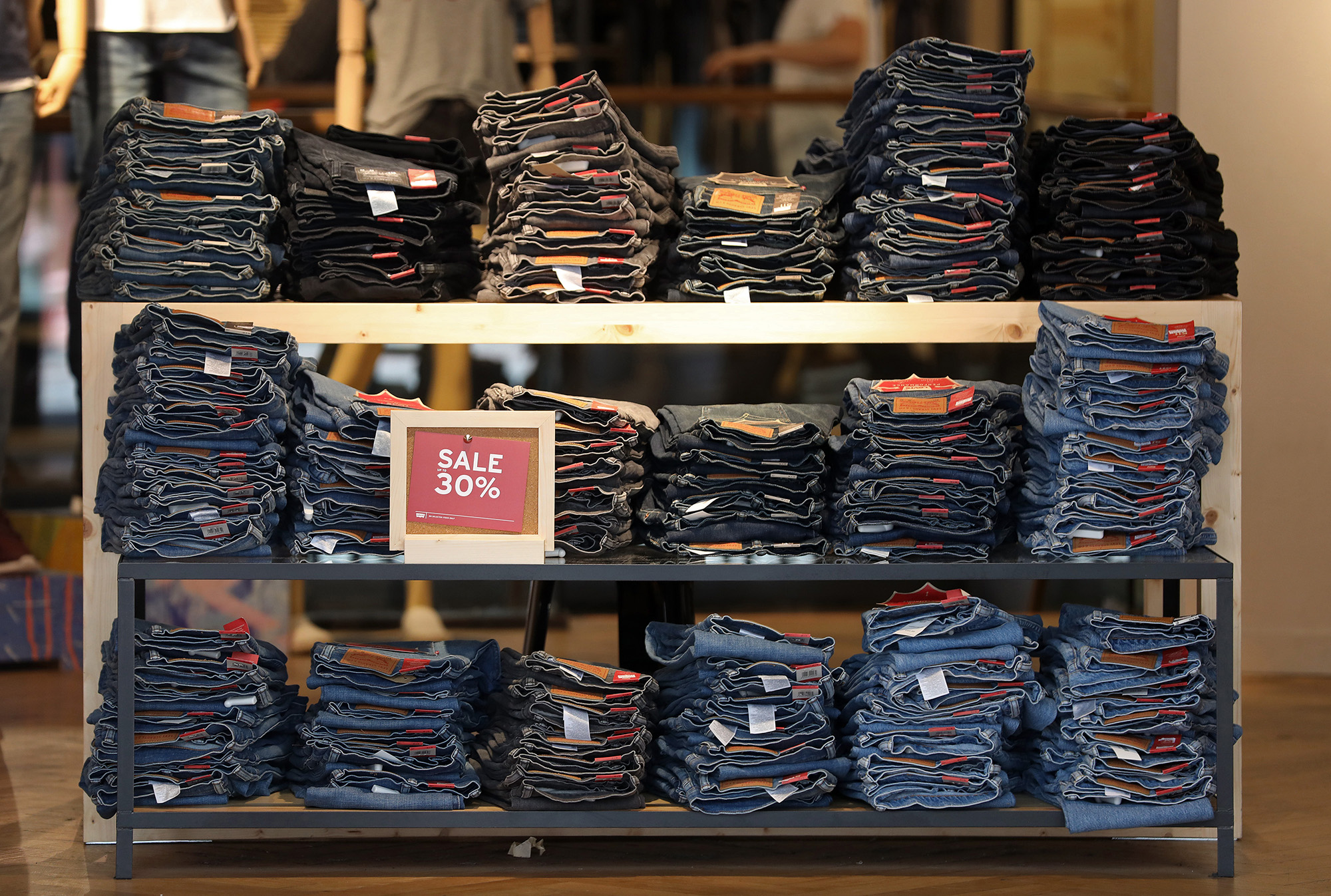 Piles of jeans sit displayed for sale inside a Levi Strauss & Co. fashion store in London