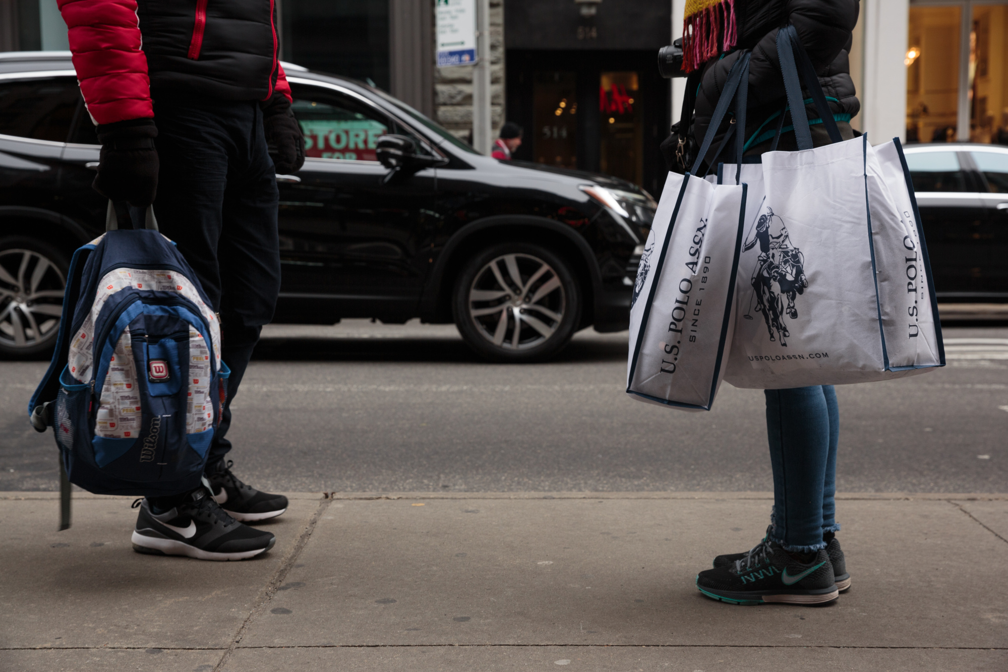 A shopper carries Ralph Lauren Corp. retail bags in the SoHo neighborhood of New York
