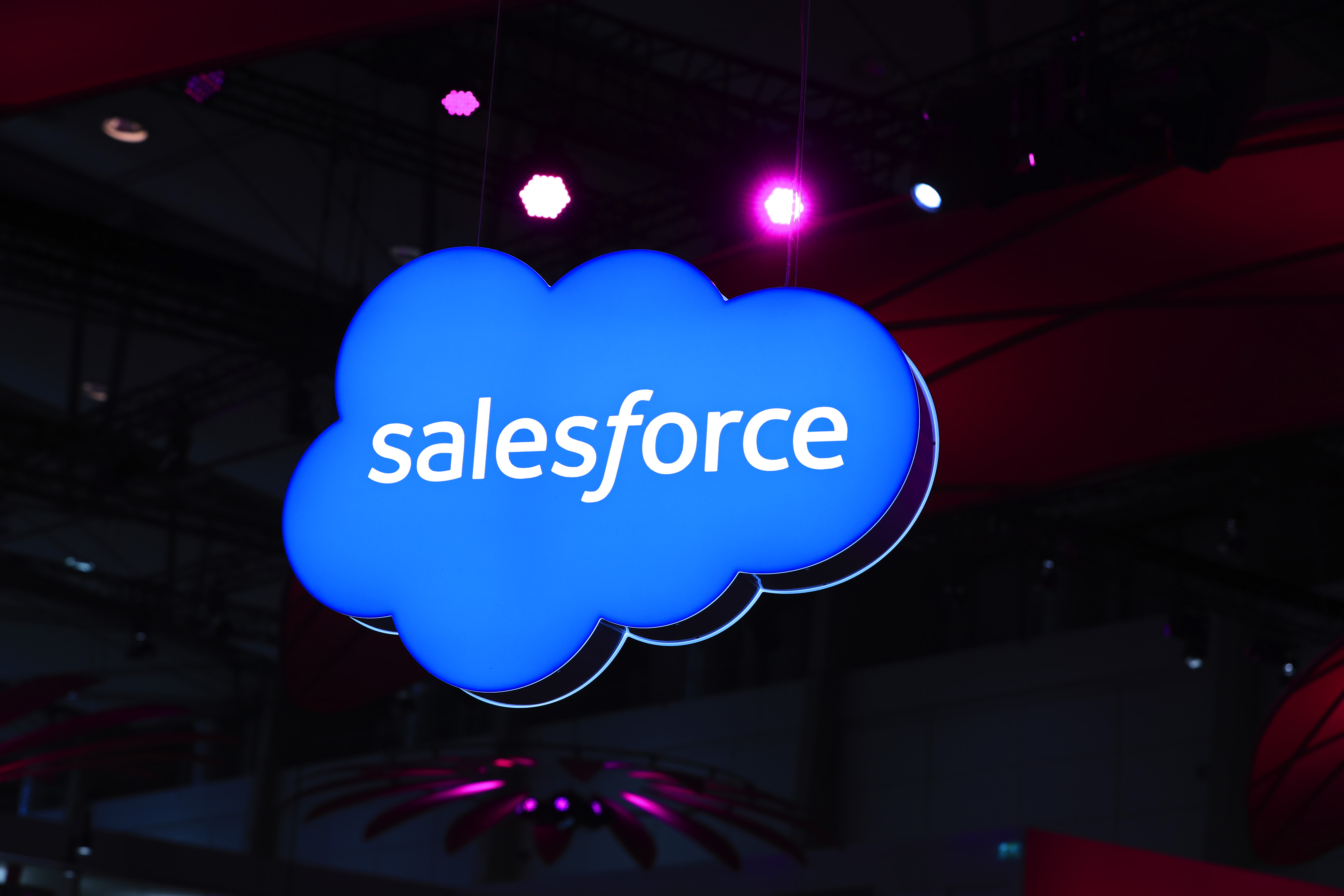A Salesforce.Com Inc. logo sits on an illuminated icloud lightbox hanging from the ceiling at the CeBIT 2017 tech fair in Hannover, Germany.