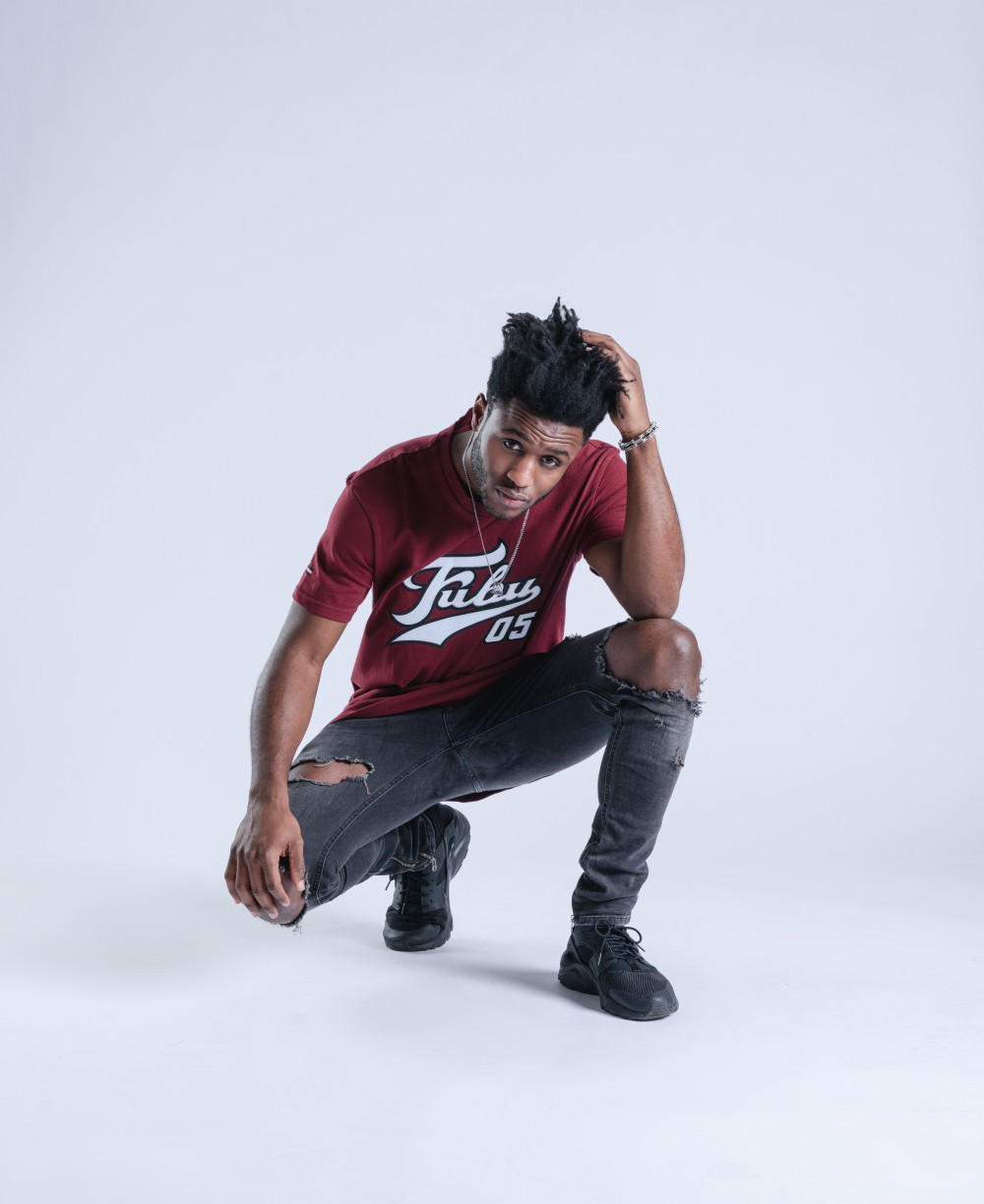 Throwback lettering emblazons a maroon t-shirt in FUBU's new capsule.