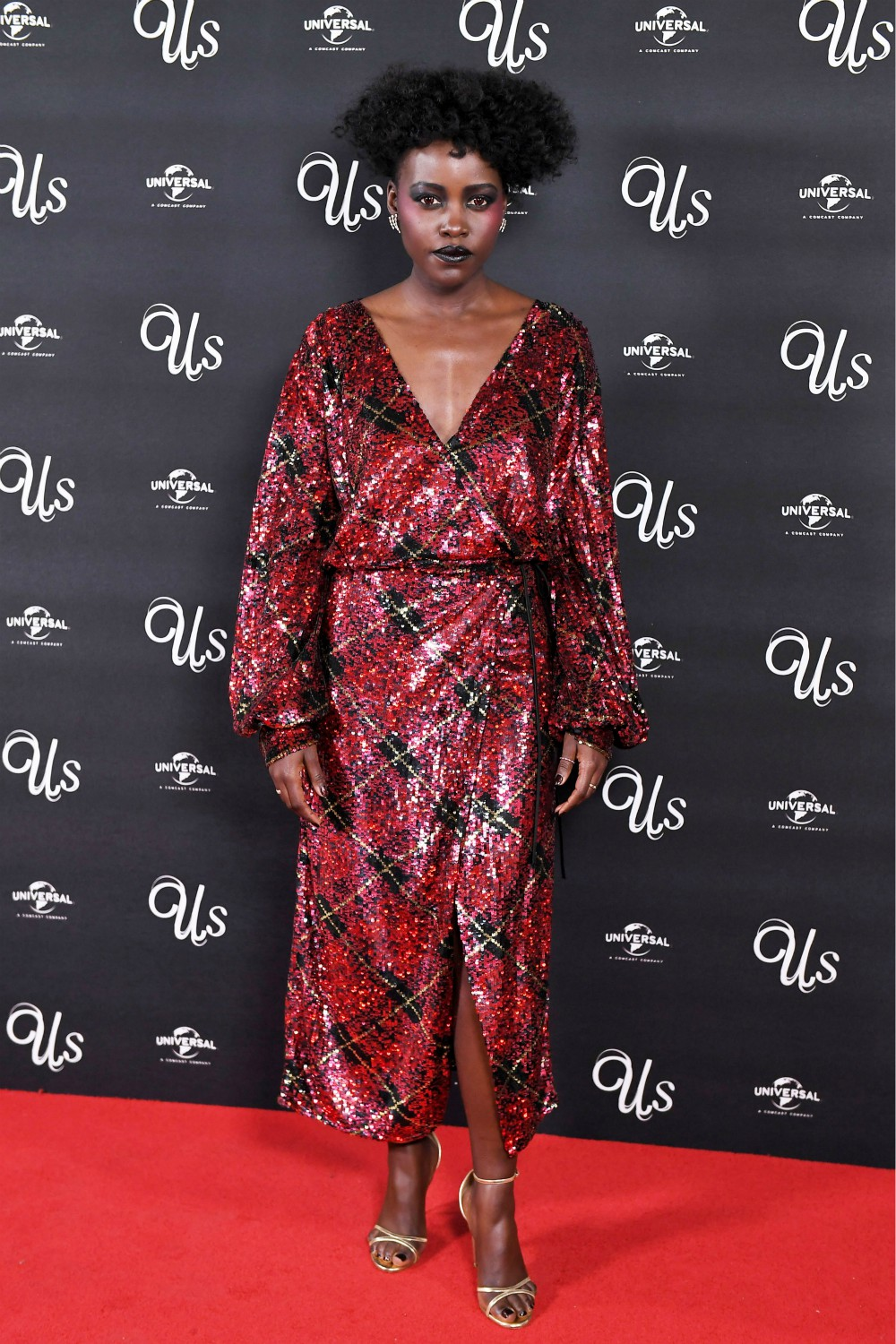 Actress Lupita N'yongo shows off Jester Red on the red carpet.