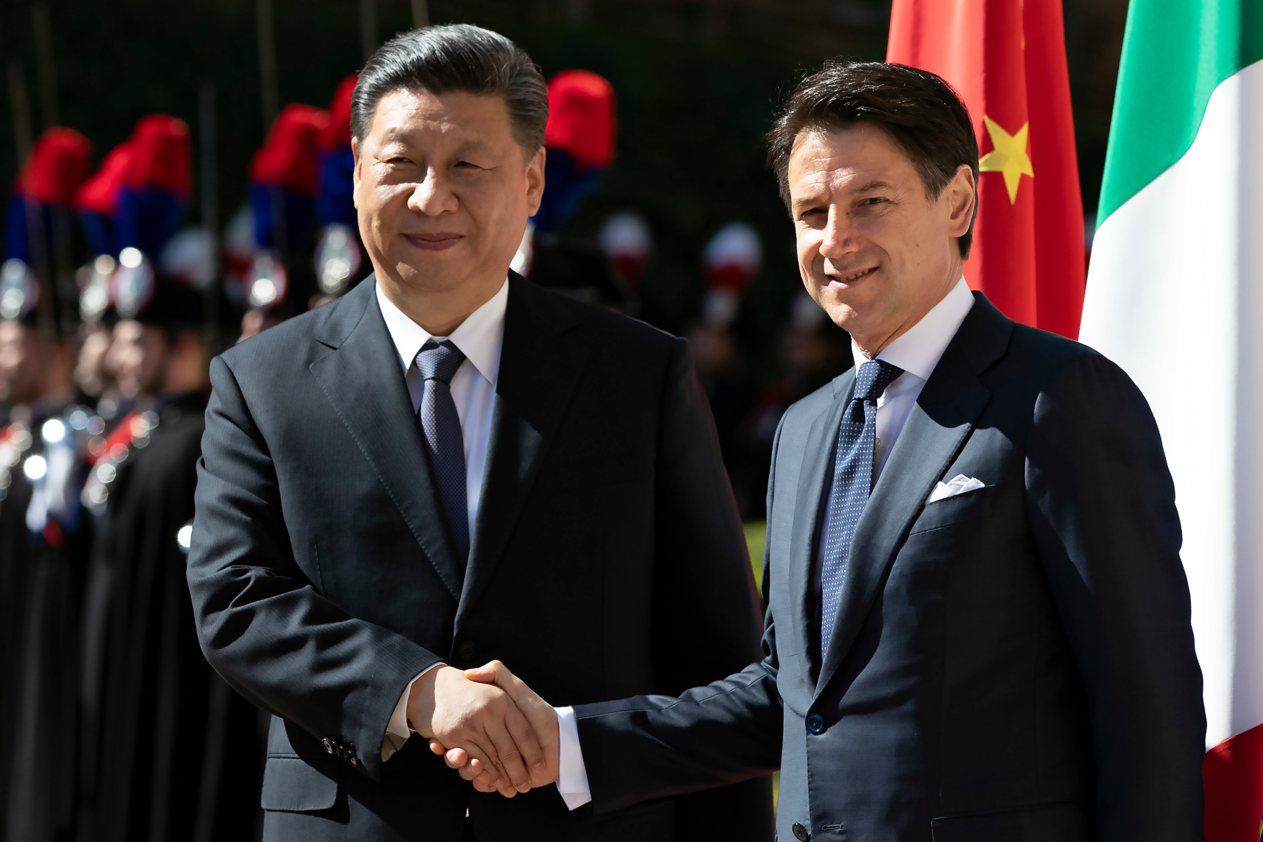 Italian premier Giuseppe Conte (R) and Chinese President Xi Jinping (L) during a welcome ceremony at the Villa Madama in Rome President of China Xi Jinping visit to Italy - 23 Mar 2019