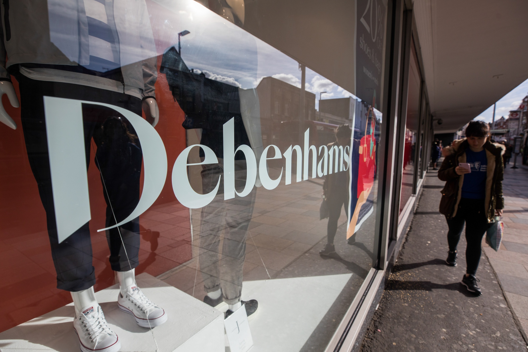A pedestrian passes a Debenhams Plc department store in London, U.K., on Monday, March 11, 2019.