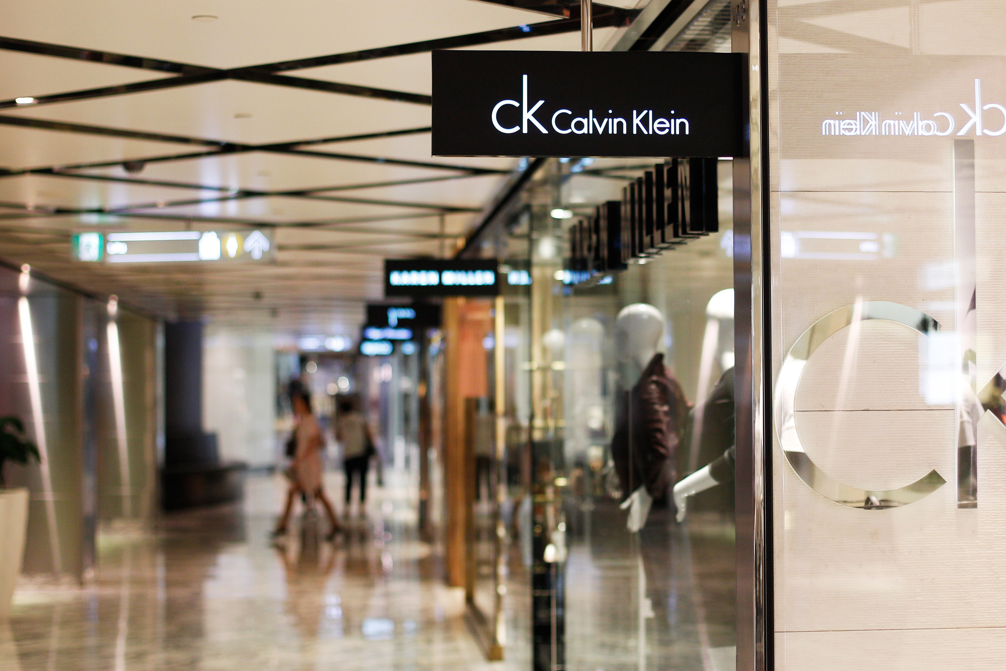 Signage for Calvin Klein Inc. is displayed at a store inside the Westfield Sydney shopping center, operated by Scentre Group, in Sydney, Australia, on Friday, Feb. 19, 2016.