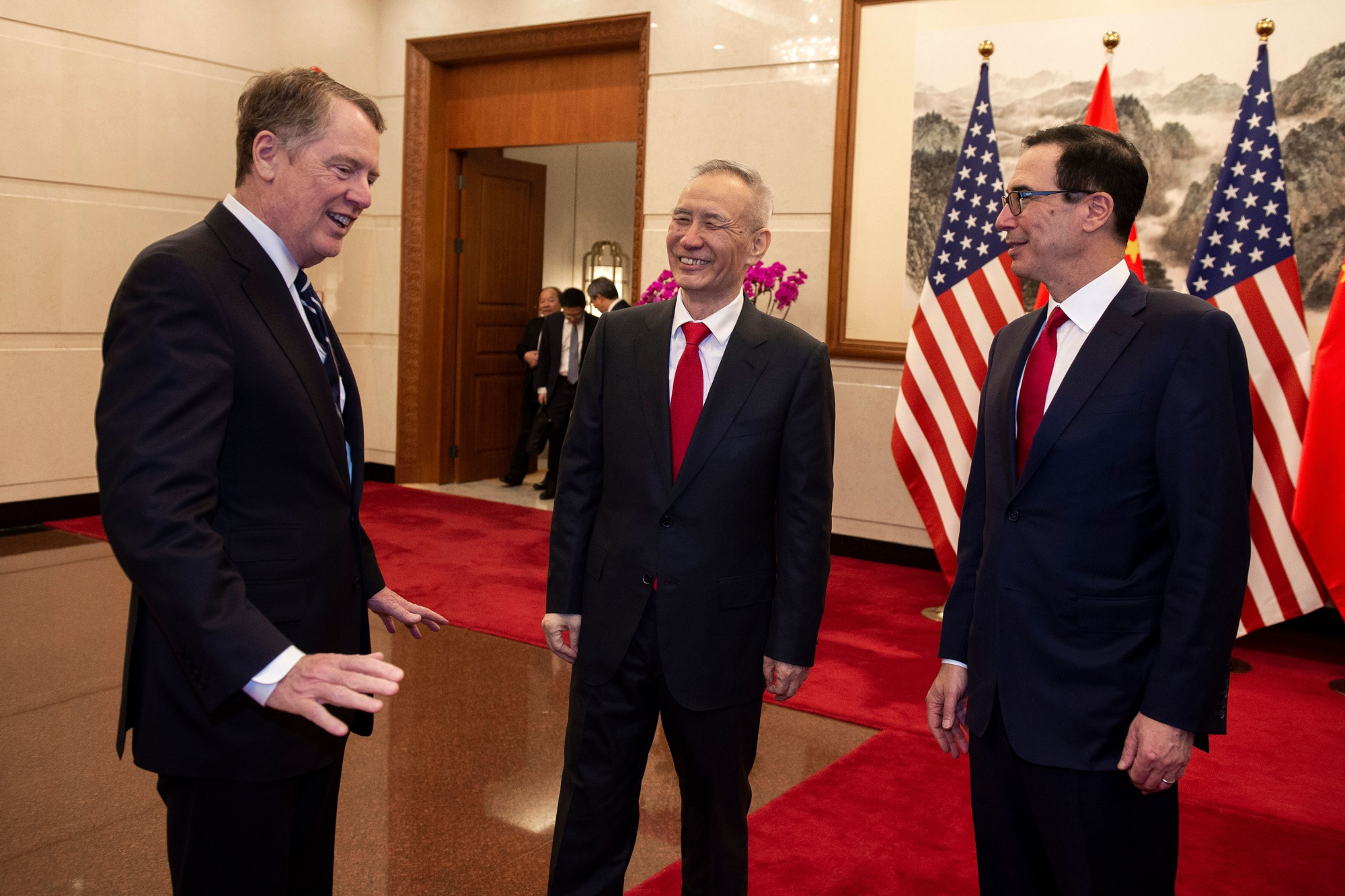 Robert Lighthizer, left, Liu He, and Steven Mnuchin on March 29.