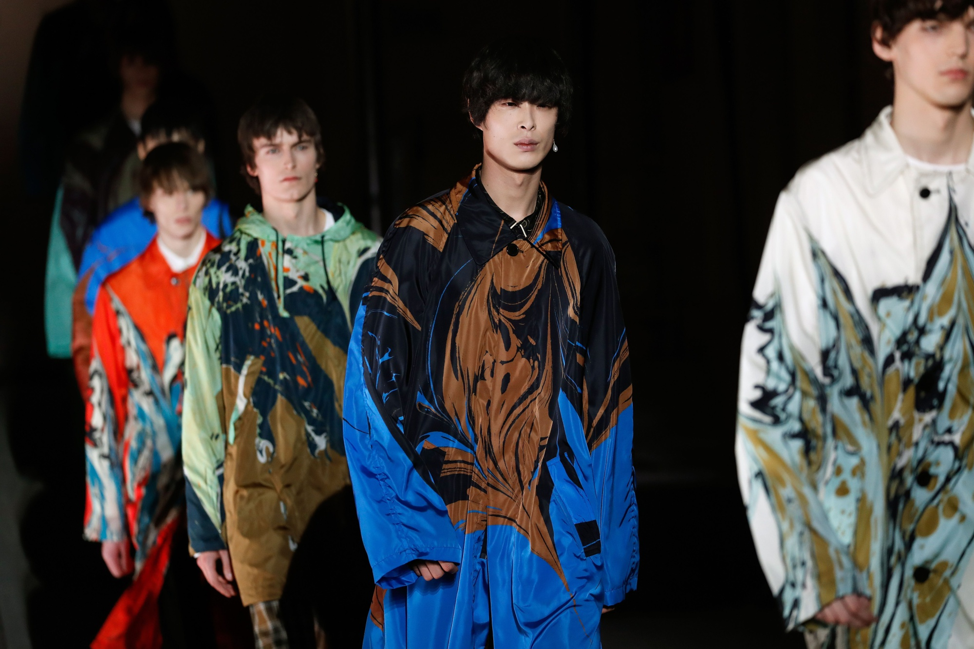 Models present creations by Dries Van Noten during the men's Fashion Week for the Fall/Winter 2018/2019 collection in Paris on January 18, 2018.