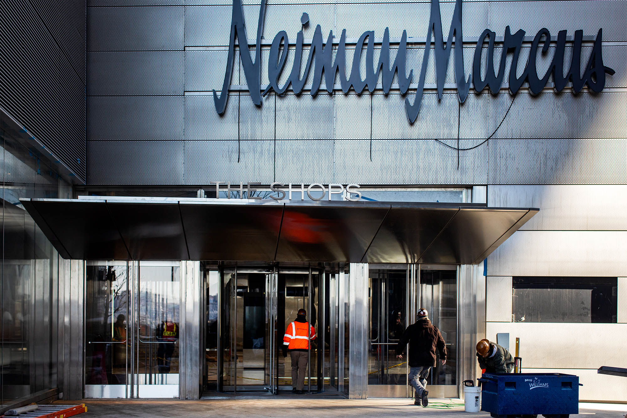 A contractor enters the Neiman Marcus store at the Hudson Yards development in New York