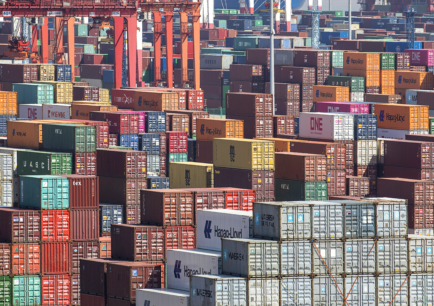 Containers sit stacked at the Yangshan Deep Water Port in Shanghai, China, on Tuesday, July 10, 2018.