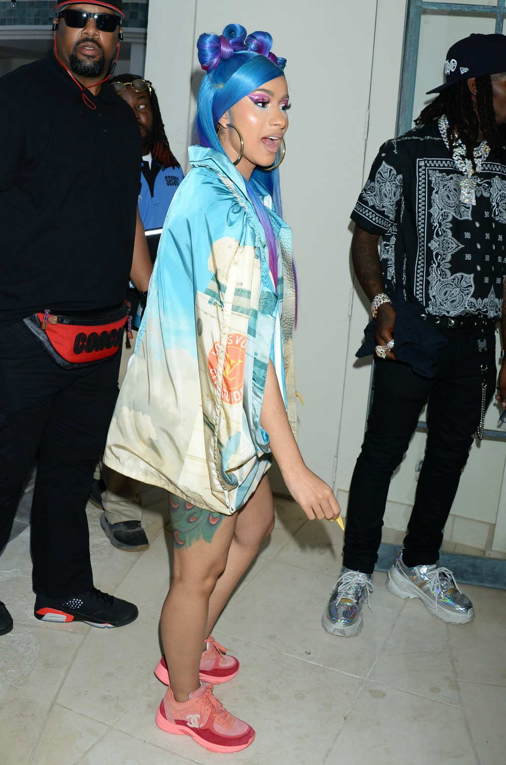 Cardi B. chases the rainbow in a colorful ensemble.