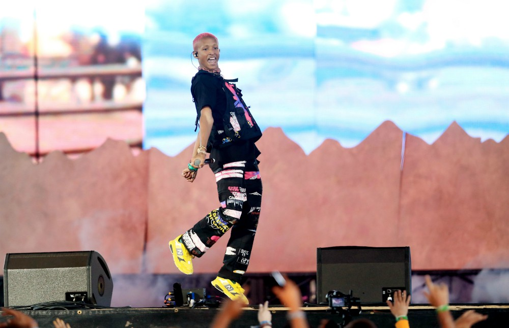 Jaden Smith takes flight in neon yellow New Balance trainers while on stage at Coachella.
