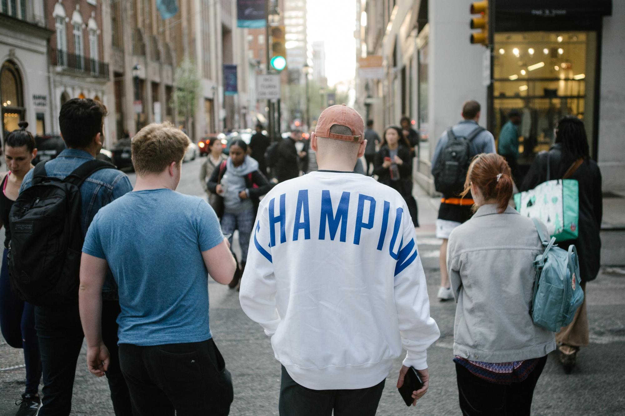 A pedestrian wears a Champion sweatshirt near the company store in Philadelphia.