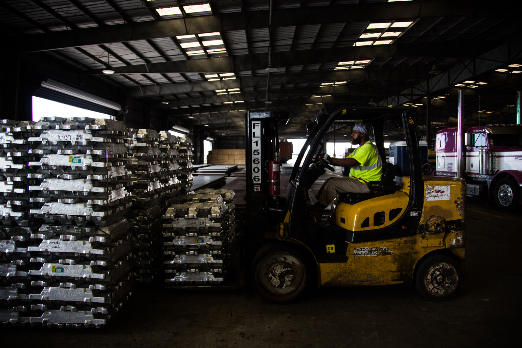 A worker uses a forklift to move aluminum ingots in a warehouse at the Port of New Orleans in New Orleans, Louisiana, U.S., on Tuesday, Sept. 18, 2018.