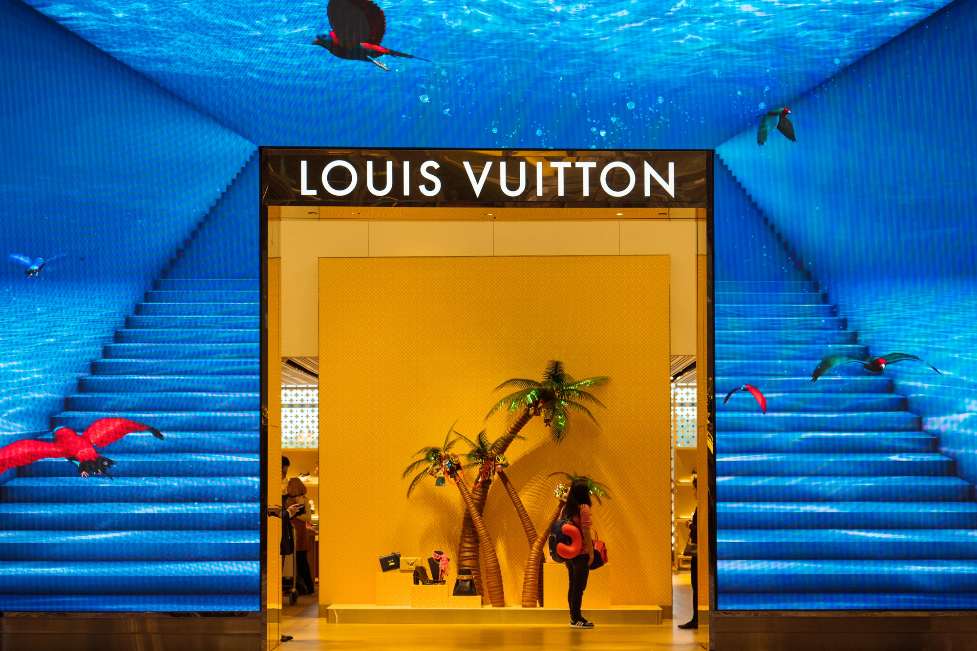 A traveler enters a LVMH Moet Hennessy Louis Vuitton SE store at Terminal 3 (T3) of Changi Airport in Singapore, on Thursday, Dec. 13, 2018.