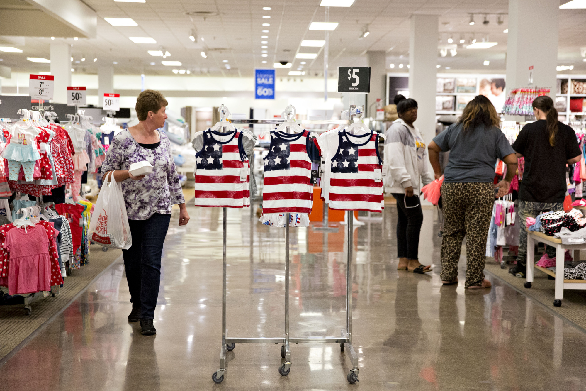 American flag themed clothing hangs on a rack inside a J.C. Penney Co. store in Peoria, Illinois, U.S., on Saturday, May 12, 2018.